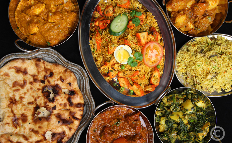 Indian curries with rice and naan