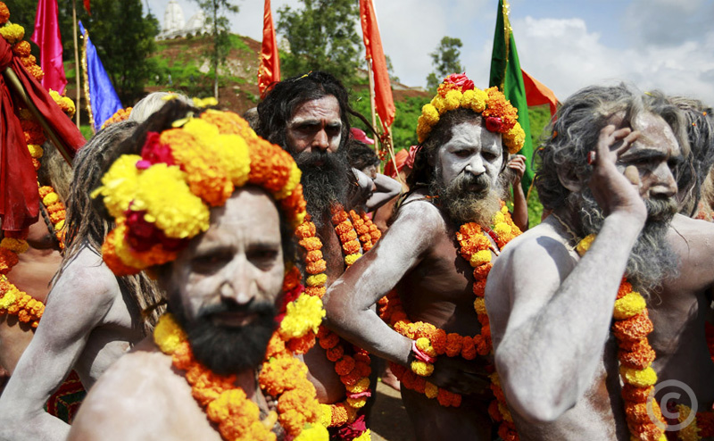 A procession of ash-smeared naked monks at the Kumbh Mela in Nashik