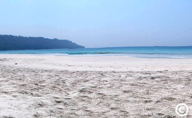Panoramic View of the beach with white sand and blue water