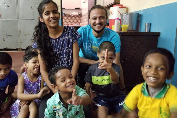 Rachit posing with children at Mother Teresa Children's Shelter in Agra. Taken May 2018